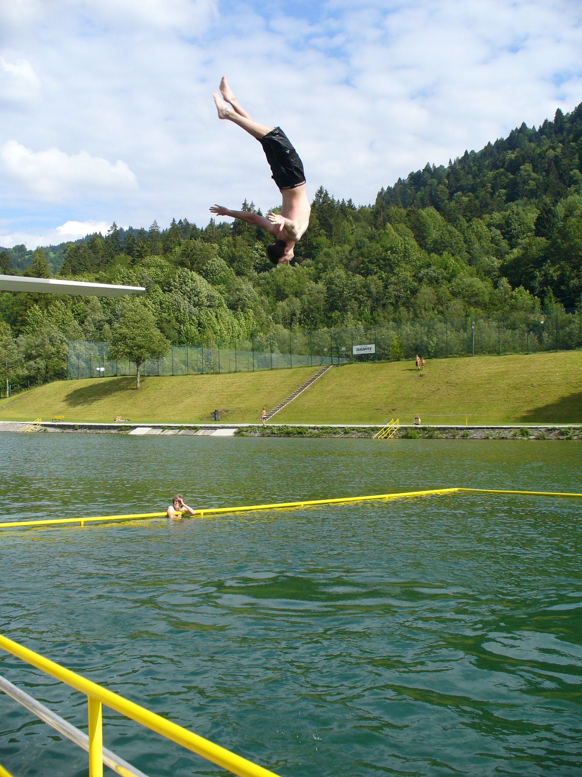 Me doing a backflip off the High Dive in a pool at the base of a mountain in the Austrian Alps