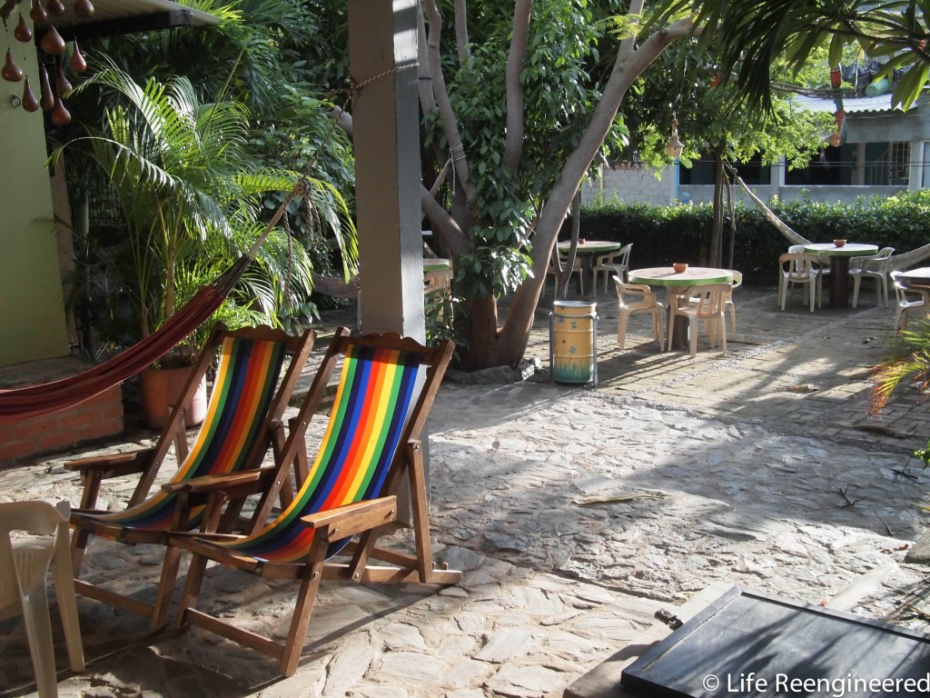 Early morning in a courtyard at hostel casa felipe, with lounge chairs and hammocks.